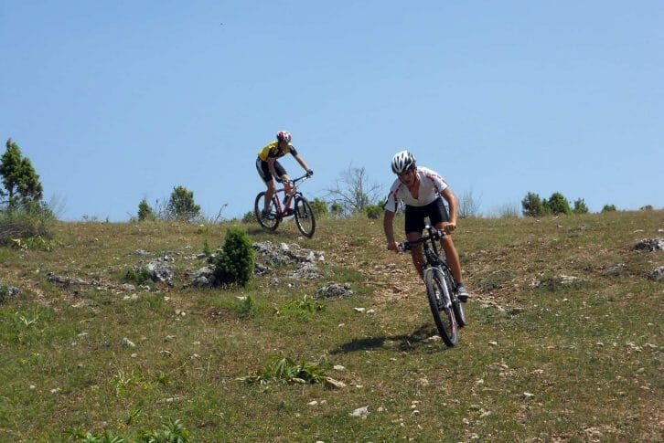 11Two biking Kosanica across the mountain range