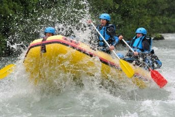 Rapid water splash into raft
