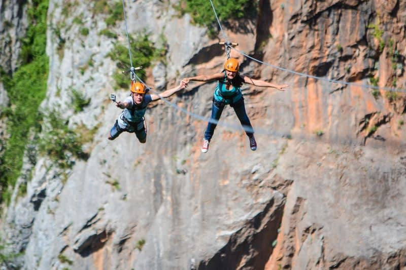 11Couple holding hands while zipling, Montenegro