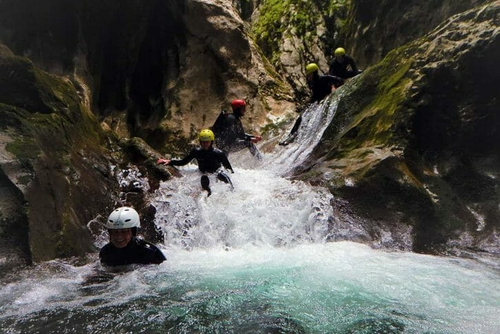 11Tourists slide down water, Nevidio Canyon