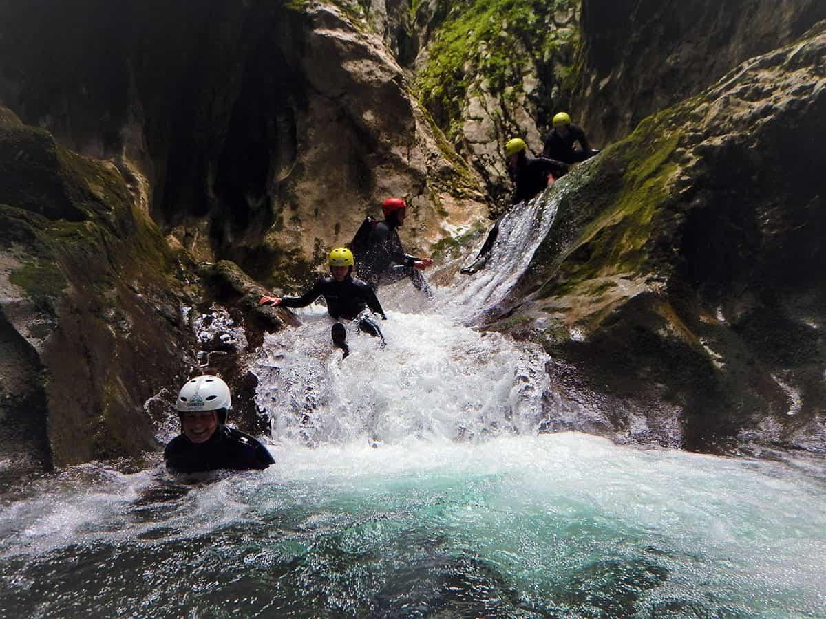 Tourists slide down water, Nevidio Canyon