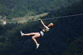 Happy girl on extreme zipline, Montenegro