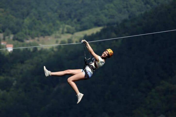 11Happy girl on extreme zipline, Montenegro