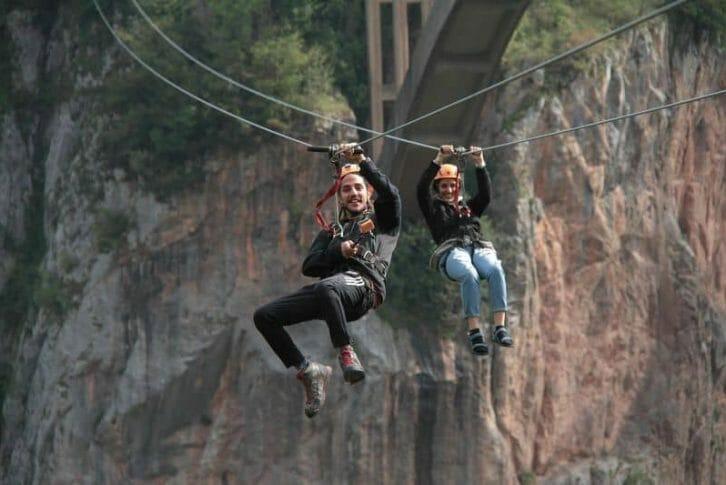 11Young couple enjoying extreme Zipline