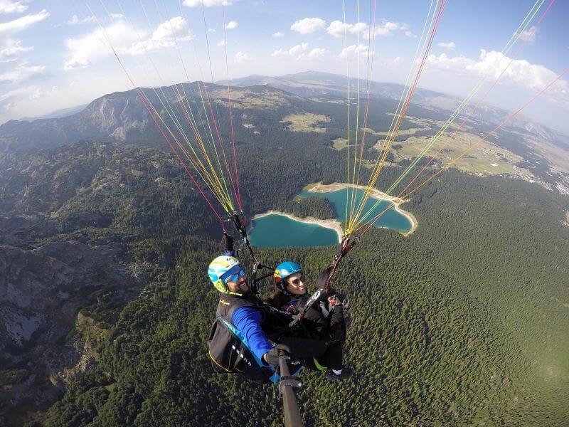 Fly over beautiful Black Lake mountains tandem paragliding Savin Kuk with Montenegro Adventure