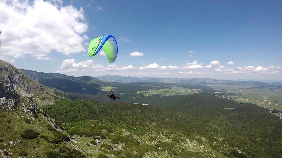 Side view panorama, beautiful sky tandem paragliding, Savin Kuk