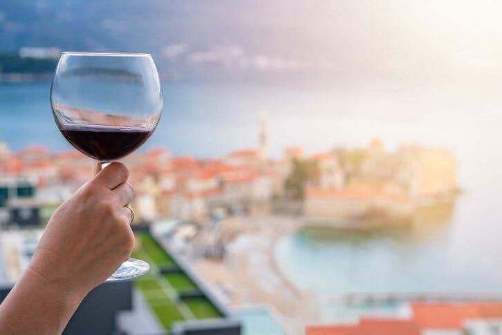 11Drinking red wine in Budva