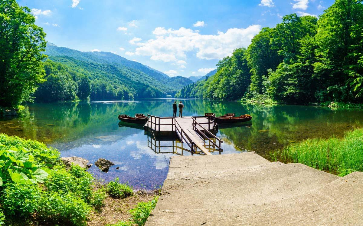 Two men enjoying the stunning view at the Biograd Lake in Montenegro