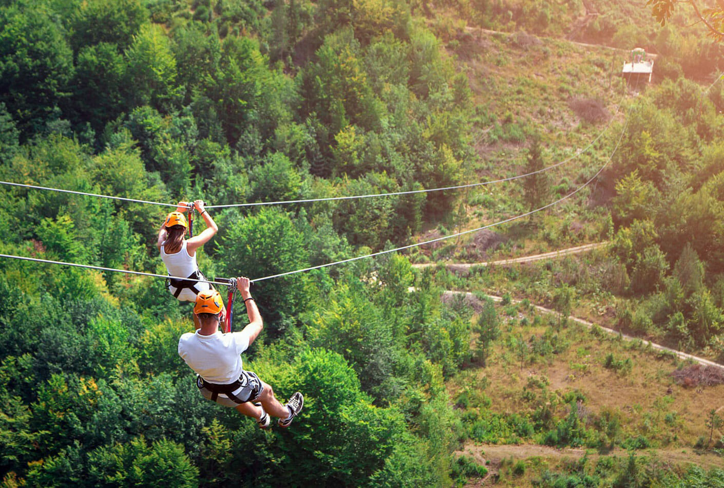 11Two tourists ziplining together, Montenegro