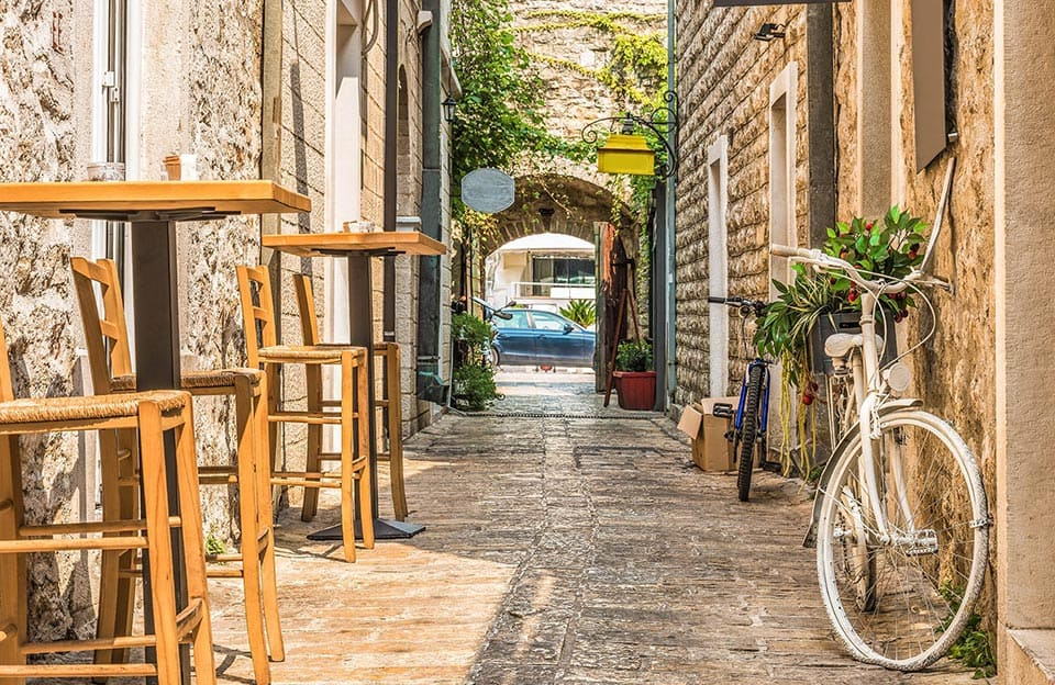 Narrow street in Budva at a cafe in Montenegro