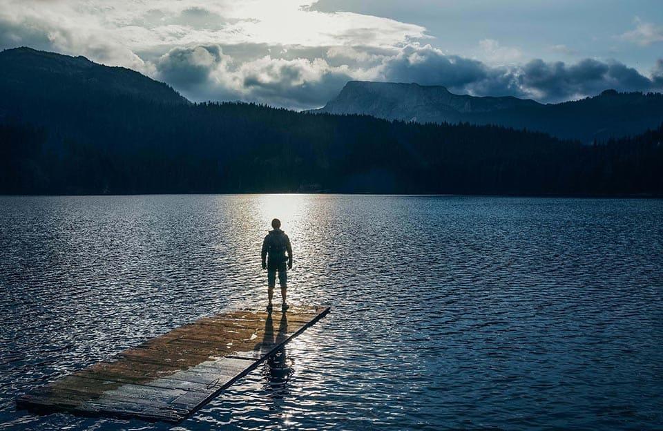 Lone trekker admiring the stunning view at Black Lake