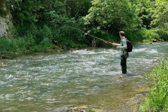 Standing in Tara river and fly fishing