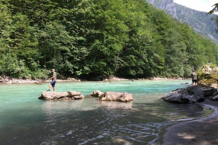 11Two men fishing in stunning Tara river in Montenegro