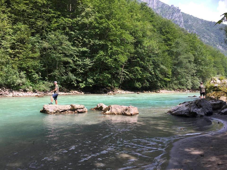 Two men fishing in stunning Tara river in Montenegro