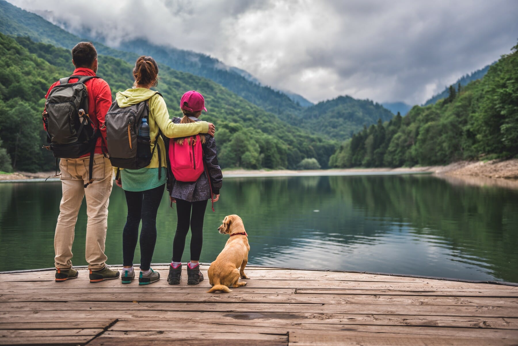 Family with dog standing on a pier Biograd Lake Montenegro