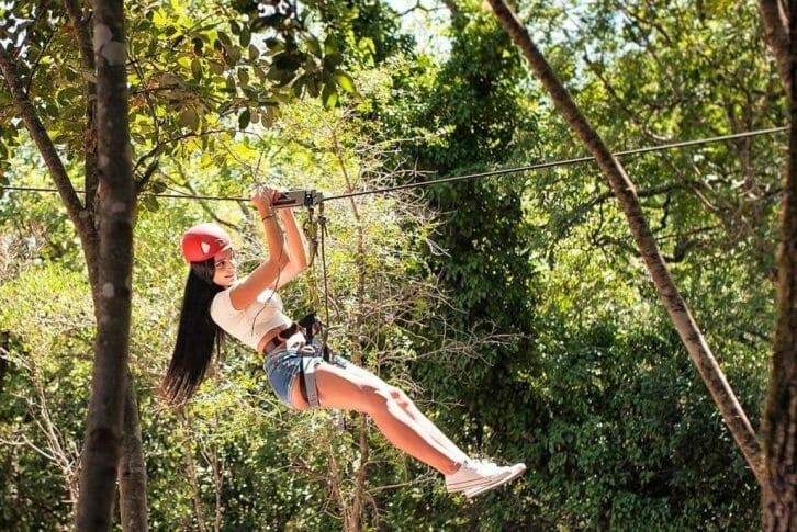 11A girl fly on Zip-Line in Adventure Park at Konavle
