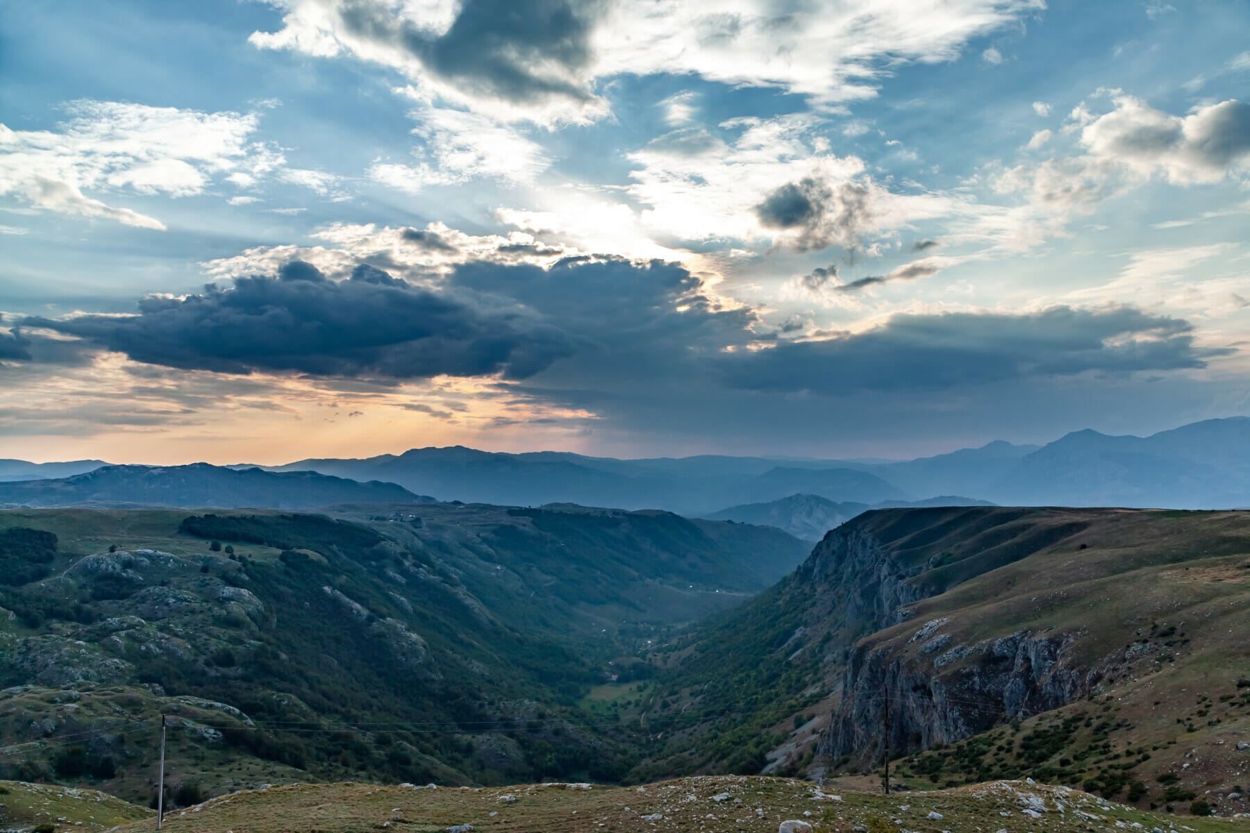 panoramic view of green valley with stones in Durmitor massif, Montenegro