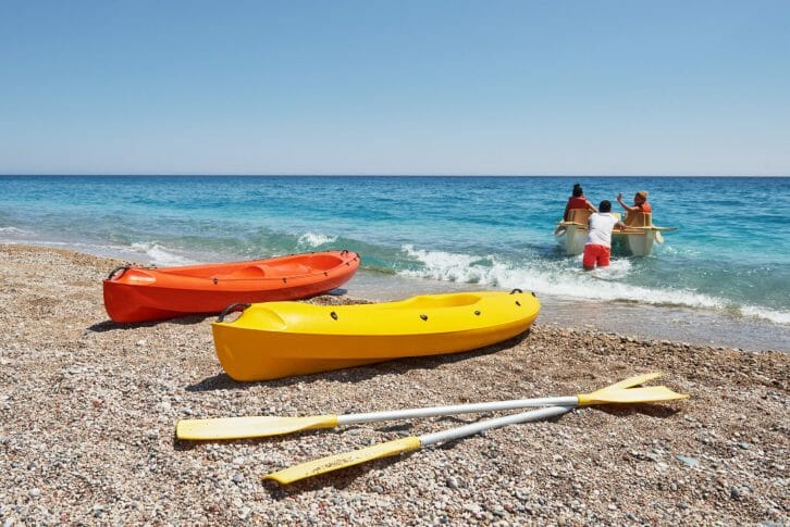11Colorful kayaks on the beach. Beautiful landscape